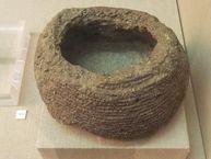 Abdruck eines kleinen Säckchens, das wohl Fava-Bohnen enthielt